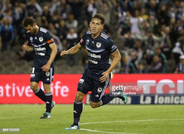 Mark Milligan of the Victory celebrates after scoring a goal during the round 10 ALeague match between the Melbourne Victory and Adelaide United at...