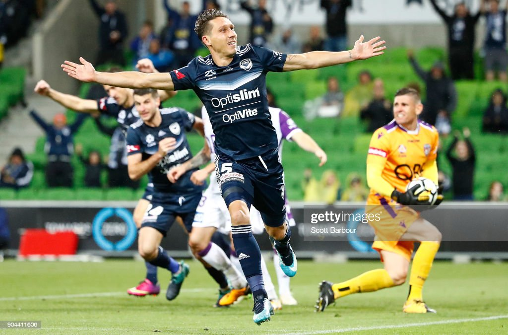Mark Milligan of the Victory celebrates after scoring his sides second goal during the round 16 A-League match between the Melbourne Victory and Perth Glory at AAMI Park on January 13, 2018 in Melbourne, Australia.