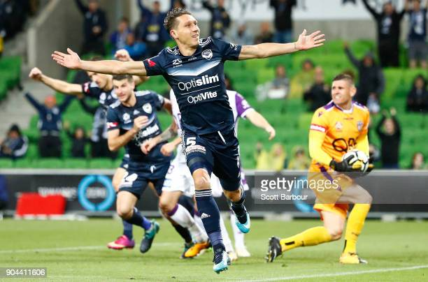 Mark Milligan of the Victory celebrates after scoring his sides second goal during the round 16 ALeague match between the Melbourne Victory and Perth...