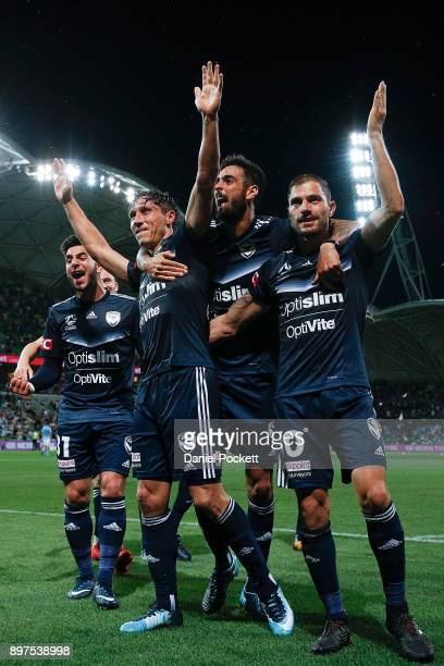 Mark Milligan of the Victory celebrates with teammates after kicking a goal during the round 12 ALeague match between Melbourne City and Melbourne...