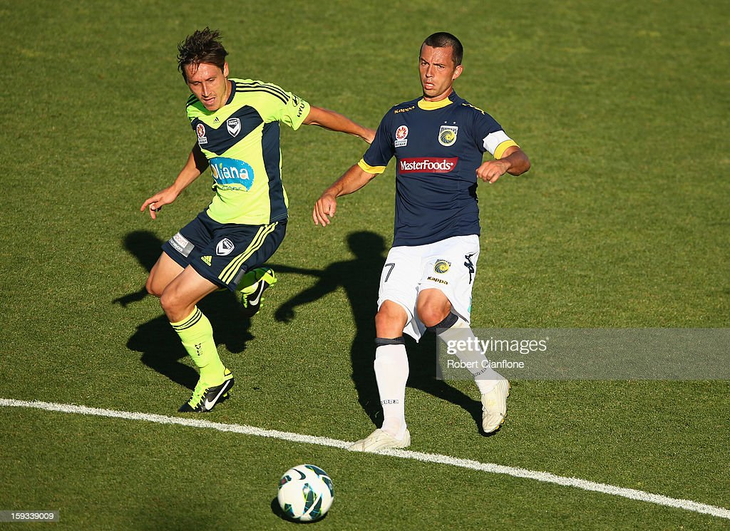 Mark Milligan of the Victory challenges John Hutchinson of the Mariners during the round 16 A-League match between the Melbourne Victory and the Central Coast Mariners at Aurora Stadium on January 12, 2013 in Launceston, Australia.