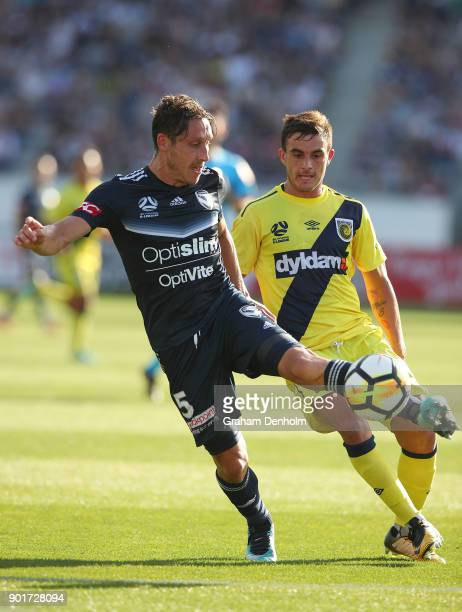 Mark Milligan of the Victory controls the ball during the round 14 ALeague match between the Melbourne Victory and the Central Coast Mariners at...