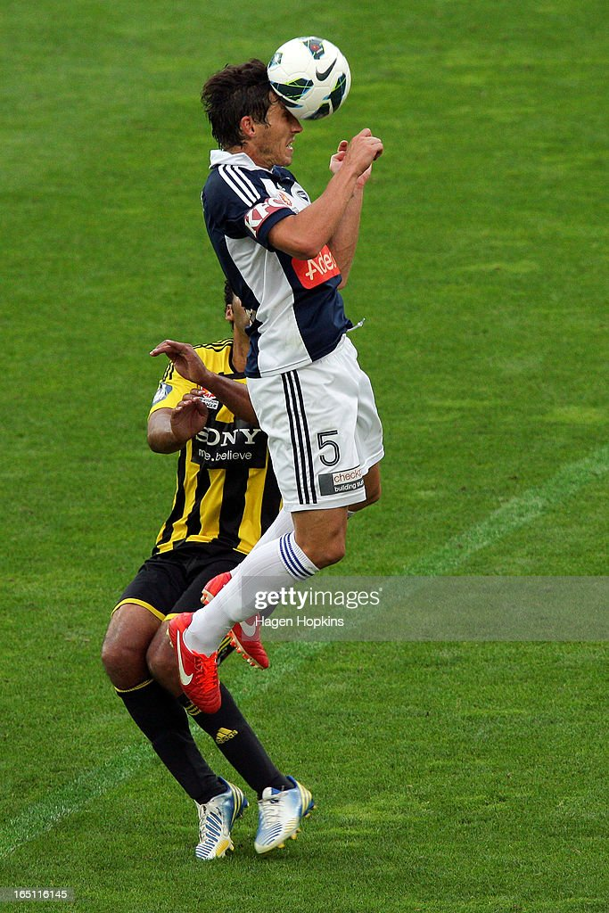 Mark Milligan of the Victory heads the ball during the round 27 A-League match between the Wellington Phoenix the Melbourne Victory at Westpac Stadium on March 31, 2013 in Wellington, New Zealand.