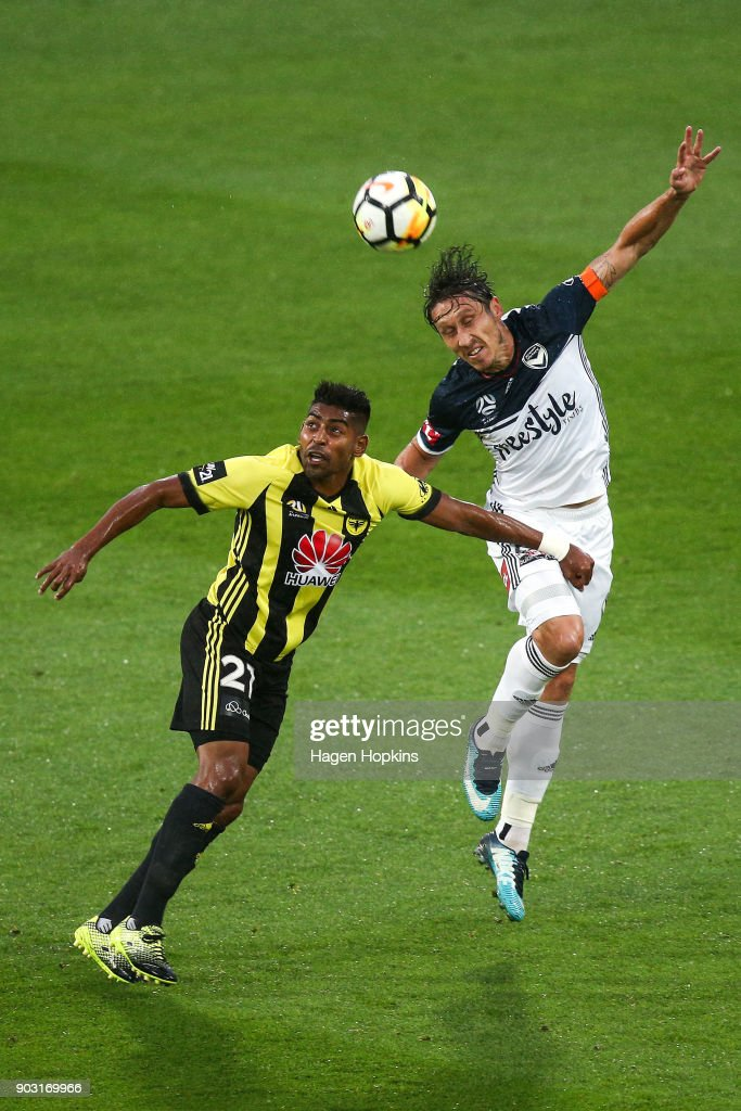 Mark Milligan of the Victory heads the ball under pressure from Roy Krishna of the Phoenix during the round 15 A-League match between the Wellington Phoenix and Melbourne Victory at Westpac Stadium on January 10, 2018 in Wellington, New Zealand.