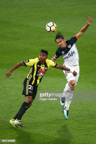 Mark Milligan of the Victory heads the ball under pressure from Roy Krishna of the Phoenix during the round 15 ALeague match between the Wellington...