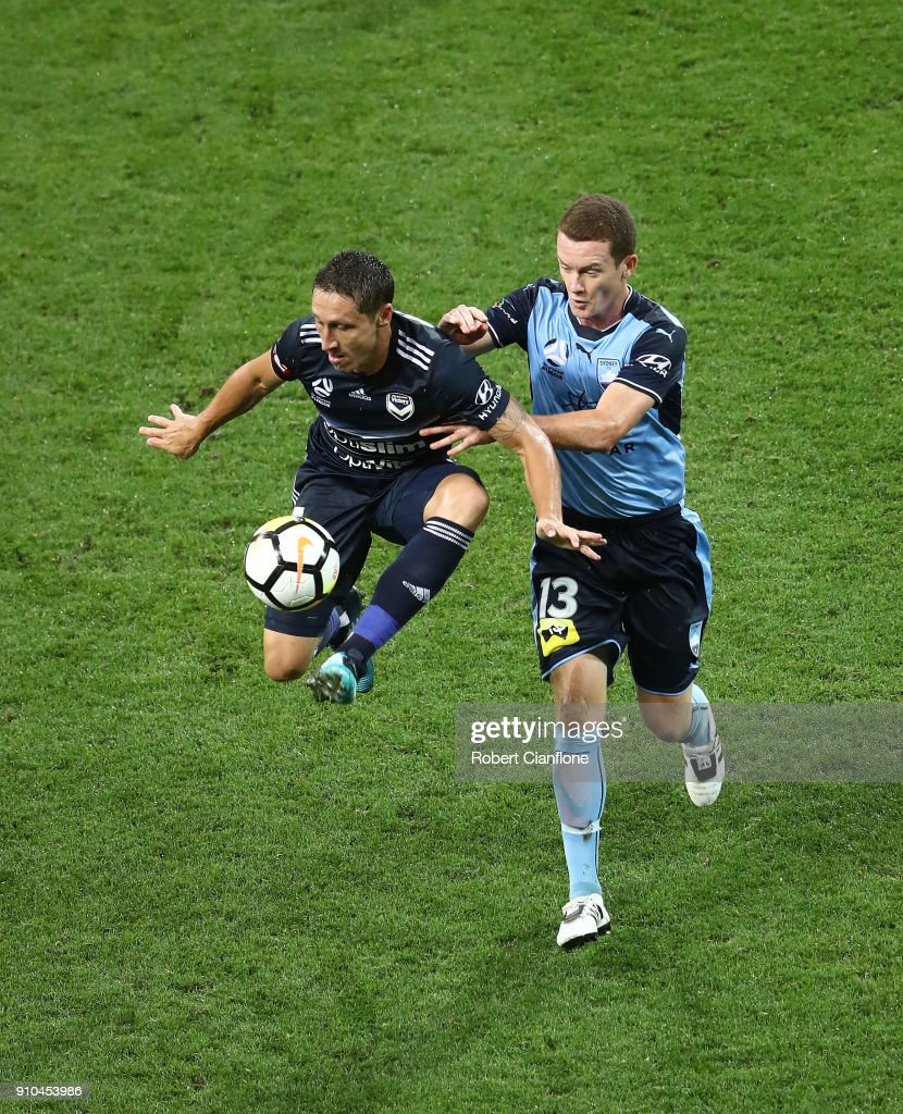 Mark Milligan of the Victory is challenged by Brandon O'Neill of Sydney FC during the round 18 A-League match between Melbourne Victory and Sydney FC at AAMI Park on January 26, 2018 in Melbourne, Australia.