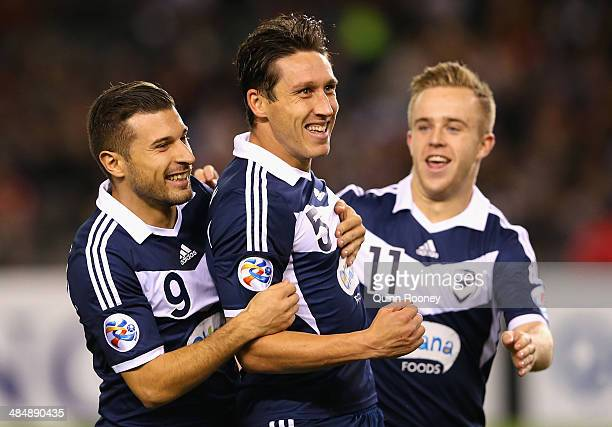 Mark Milligan of the Victory is congratulated by Kosta Barbarouses and Connor Pain after scoring a goal during the AFC Asian Champions League match...
