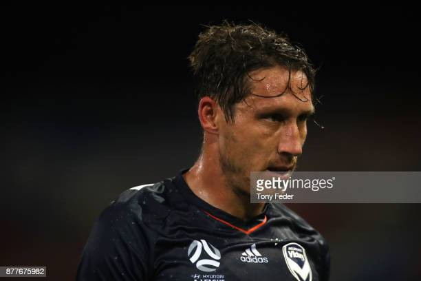 Mark Milligan of the Victory walks from the ground after being sent off during the round eight ALeague match between the Newcastle Jets and the...