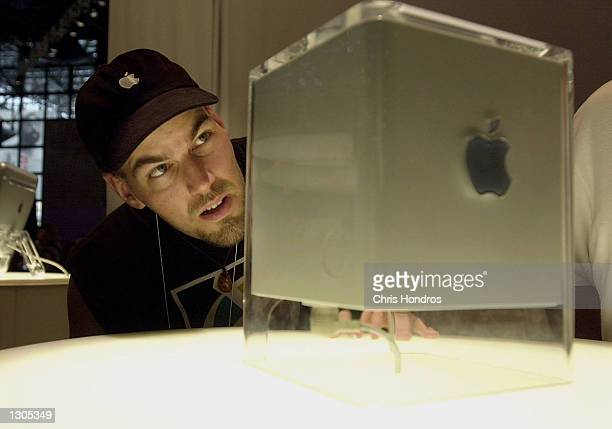 Mark Mineart of New York eyes Apple''s new G4 Cube July 21 2000 at the Macworld Conference and Expo at the Javits Center in New York City Apple...