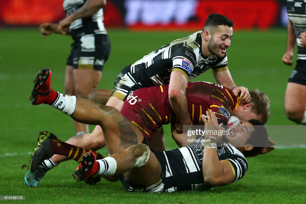 Mark Minichiello and Fetuli Talanoa of Hull FC tackle Ryan Hinchcliffe of Huddersfield Giants during the BetFred Super League match between Hull FC and Huddersfield Giants at KCOM Stadium on February 1, 2018 in Hull, England.