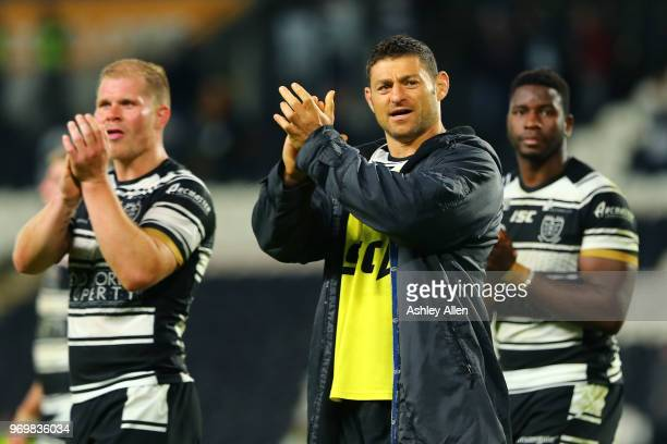 Mark Minichiello ,Danny Washbrook and Masi Matongo of Hull FC applaud the crowd during the Betfred Super League match between Hull FC and Salford Red...