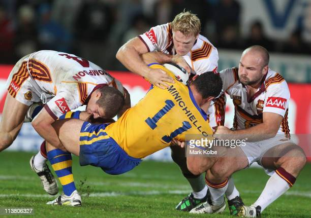 Mark Minichiello of City is tackled during the ARL Origin match between Country and City at Lavington Sports Ground on May 6, 2011 in Albury,...