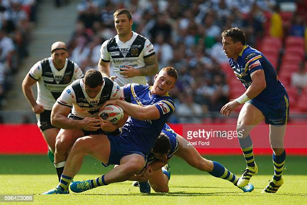 Mark Minichiello of Hull FC is tackled by Jack Hughes of the at Wembley Stadium on during the Ladbrokes Challenge Cup Final between Hull FC and...