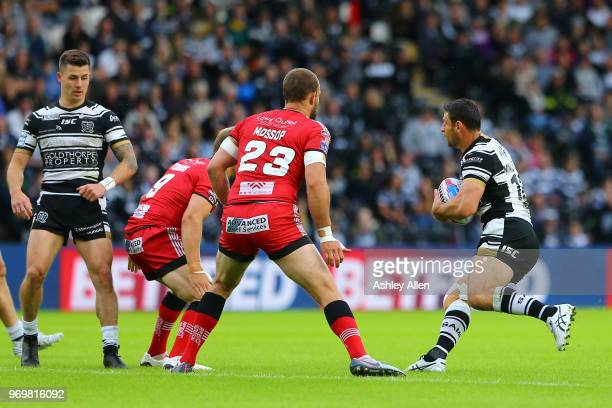 Mark Minichiello of Hull FC looks for a gap to run through during the Betfred Super League match between Hull FC and Salford Red Devils at KCOM...