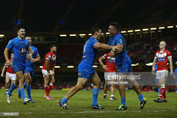 Mark Minichiello of Italy celebrates scoring a try with Joel Rieithmuller during the Rugby League World Cup Inter group match between Wales and Italy...