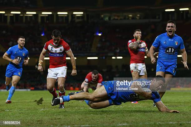 Mark Minichiello of Italy scores a try during the Rugby League World Cup Inter group match between Wales and Italy at the Millennium Stadium on...