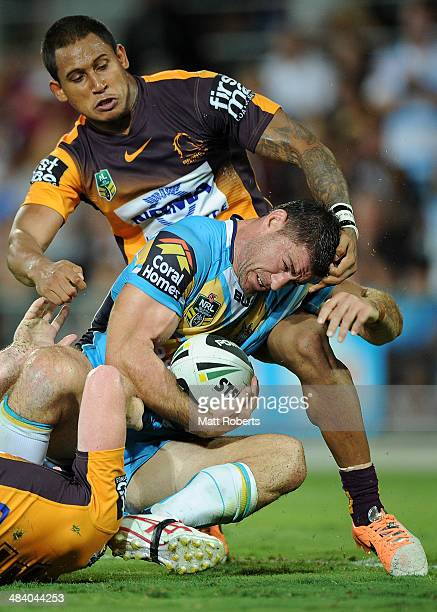 Mark Minichiello of the Titans is held up on the try line during the round 6 NRL match between the Gold Coast Titans and the Brisbane Broncos at Cbus...