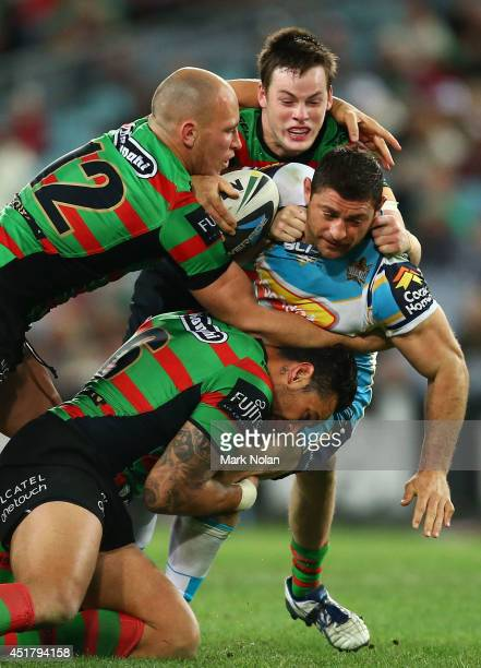 Mark Minichiello of the Titans is tackled during the round 17 NRL match between the South Sydney Rabbitohs and the Gold Coast Titans at ANZ Stadium...
