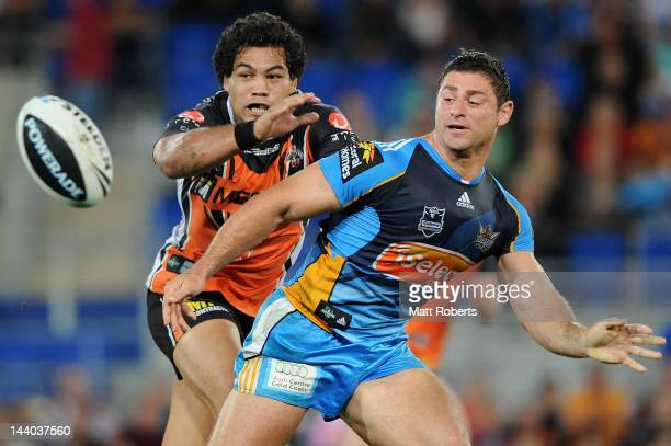Mark Minichiello of the Titans offloads the ball during the round nine NRL match between the Gold Coast Titans and the Wests Tigers at Skilled Park...