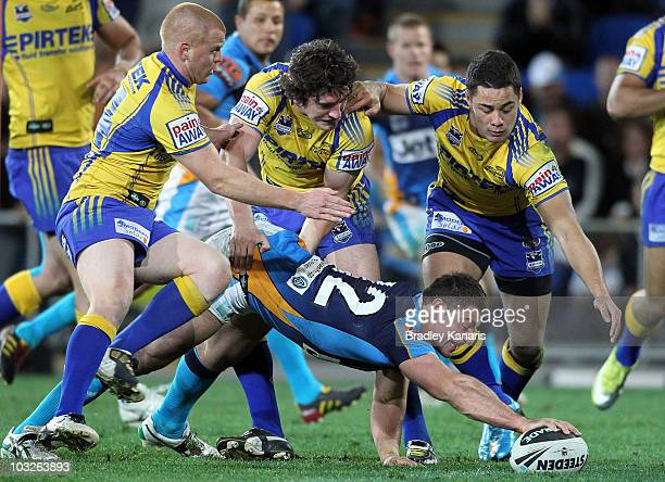 Mark Minichiello of the Titans reaches out to score a try during the round 22 NRL match between the Gold Coast Titans and the Parramatta Eels at...