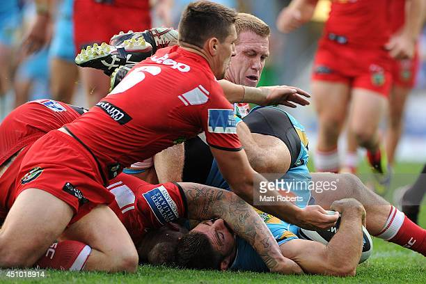 Mark Minichiello of the Titans scores a try during the round 15 NRL match between the Gold Coast Titans and the St George Illawarra Dragons at Cbus...