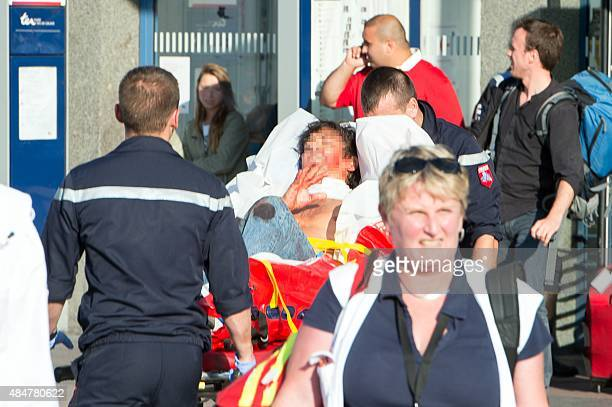 Mark Moogalian a 51yearold FrancoAmerican professor is carried away on a stretcher from the train station of Arras northern France after being shot...