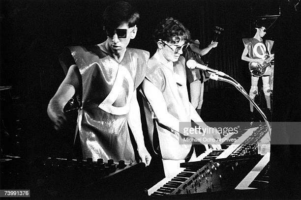 Mark Mothersbaugh and other members of the new wave punk music group Devo wears a mask and costume as he performs onstage in circa 1979 in Los...