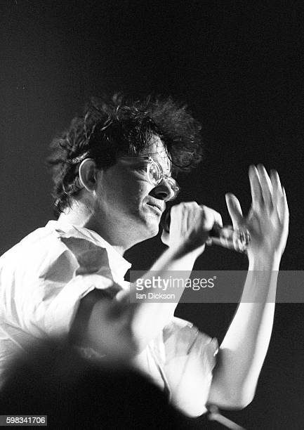 Mark Mothersbaugh of Devo performing on stage at Town Country Club Kentish Town London 15 October 1990