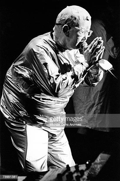 Mark Mothersbaugh of the new wave punk music group Devo wears a mask and costume as he performs onstage in circa 1979 in Los Angeles California