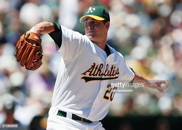 Mark Mulder of the Oakland Athletics pitches against the Chicago White Sox during a MLB game at the Network Associates Coliseum on July 18 2004 in...