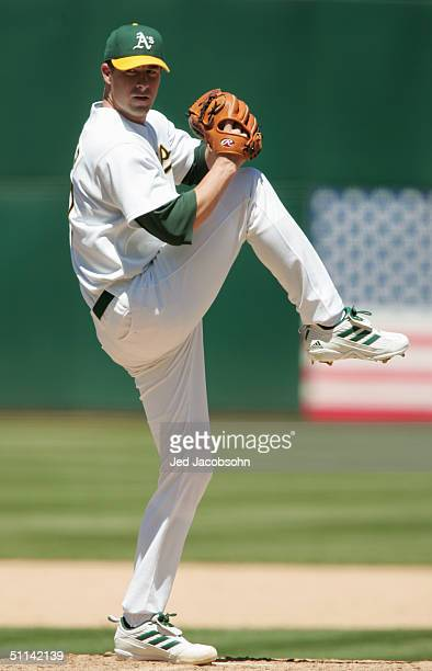 Mark Mulder of the Oakland Athletics pitches during the game against the Chicago White Sox at the Network Associates Coliseum on July 18 2004 in...