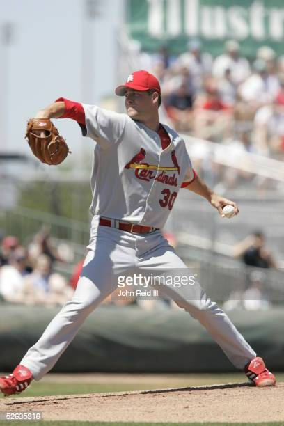 Mark Mulder of the St Louis Cardinals pitches during the Spring Training game against the Florida Marlins at Roger Dean Stadium on March 29 2005 in...