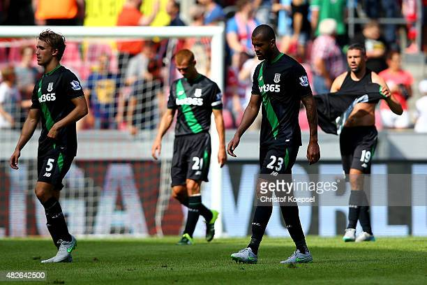Mark Muniesa Steve Sidwell Dionatan Teixeira and Jonathan Walters of Stoke City look dejected after the Colonia Cup 2015 match between 1 FC Koeln and...