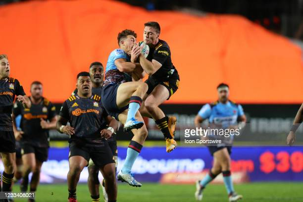 Mark Nawaqanitawase of the Waratahs and Kaleb Trask of the Chiefs jumps for the ball during the round five Super Rugby Trans Tasman match between the...