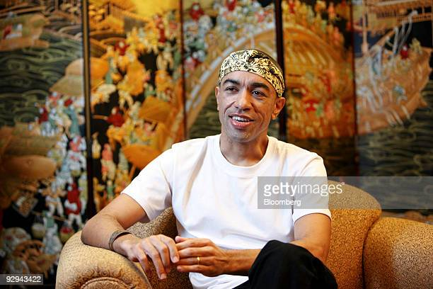 Mark Ndesandjo half brother of US President Barrack Obama speaks during an interview in Shenzhen China on Monday Nov 9 2009 Ndesandjo who shares the...