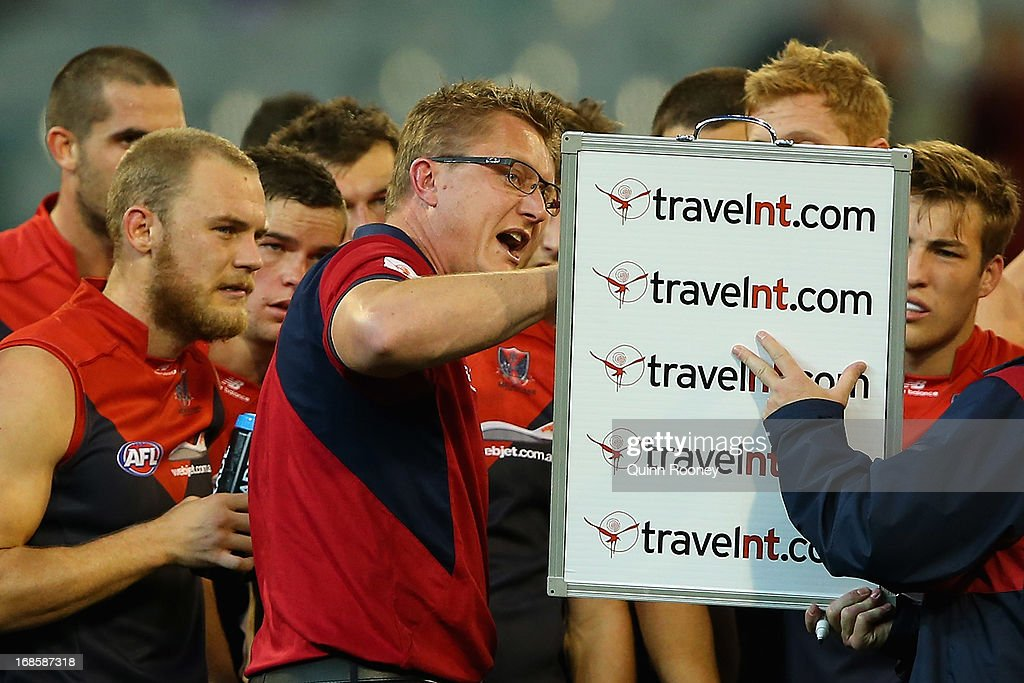 Mark Neeld the coach of the Demons talks to his players during the round seven AFL match between the Melbourne Demons and the Gold Coast Suns at Melbourne Cricket Ground on May 12, 2013 in Melbourne, Australia.