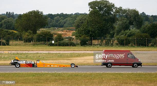 Mark Newby of Oxford has his afterburning jet car 'Split Second' towed back, after the front wheel split in an attempt to break the British Landspeed...