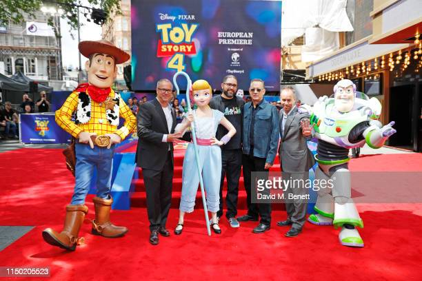 Mark Nielsen Josh Cooley Tom Hanks and Jonas Rivera pose with characters from Toy Story at the European Premiere of Toy Story 4 at Odeon Luxe...
