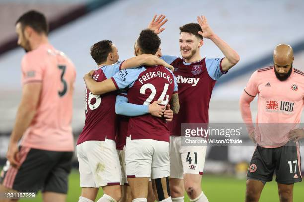 Mark Noble and Declan Rice celebrate with Ryan Fredericks of West Ham United after he scores their 3rd goal during the Premier League match between...