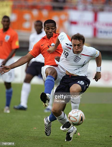Mark Noble of England gets tackled by Maceo Rigters of the Netherlands during the UEFA European Under-21 Championship semi-final match between the...