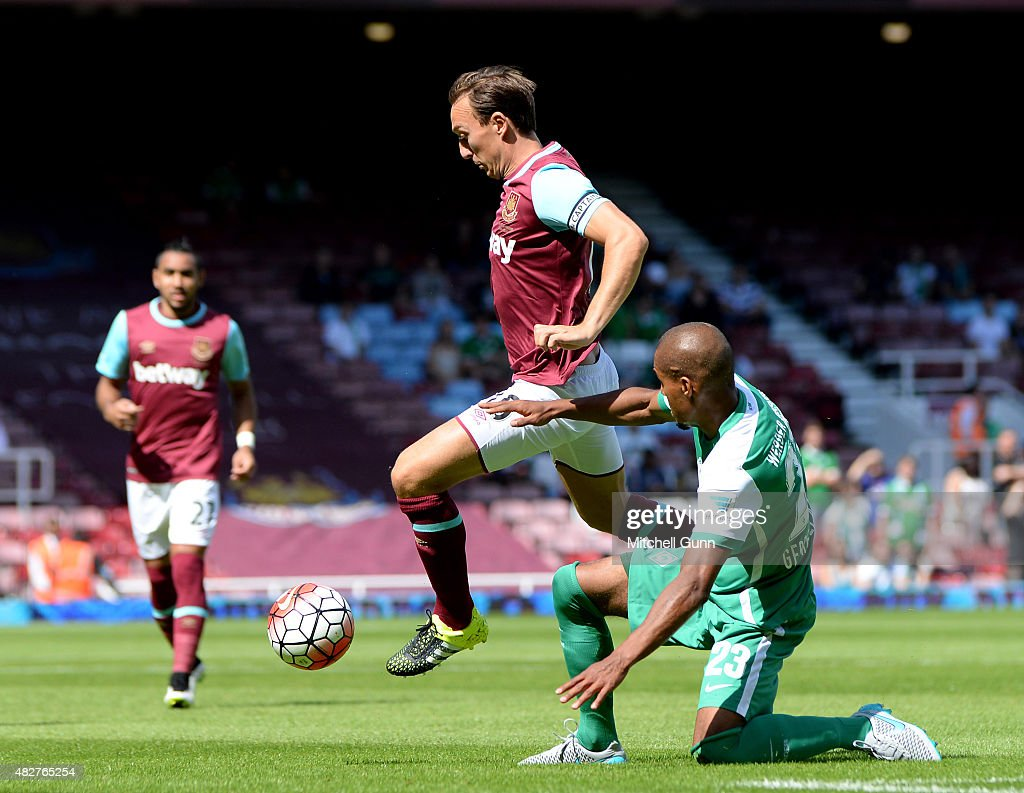 Mark Noble of West Ham and Theodor Gebre Selassie of Werder Bremen compete for the ball during the Betway Cup match between West Ham United and Werder Bremen at Boleyn Ground on August 2, 2015 in London, England.