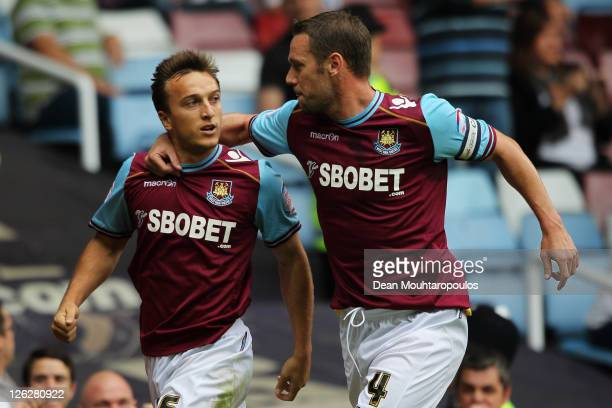 Mark Noble of West Ham celebrates scoring the first goal of the game from the penalty spot with team mate Kevin Nolan during the npower Championship...