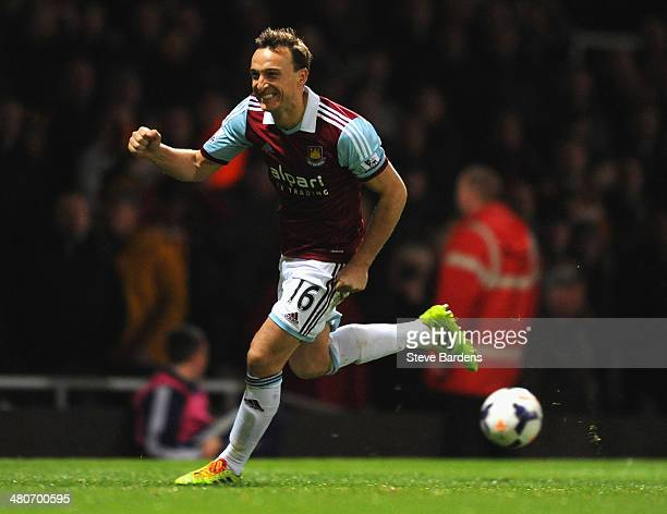Mark Noble of West Ham celebrates scoring the opening goal from the penalty spot during the Barclays Premier League match between West Ham United and...