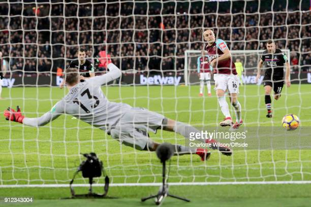 Mark Noble of West Ham scores the equalising goal from the penalty spot during the Premier League match between West Ham United and Crystal Palace at...