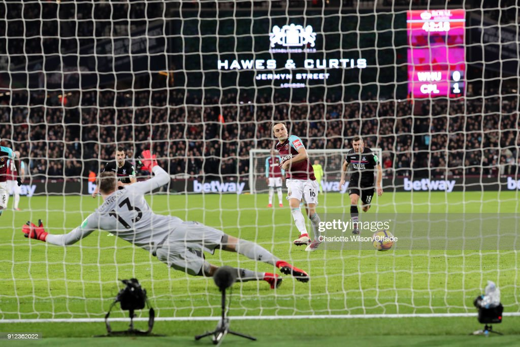 Mark Noble of West Ham scores the equalising goal from the penalty spot during the Premier League match between West Ham United and Crystal Palace at London Stadium on January 30, 2018 in London, England.
