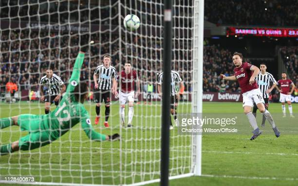 Mark Noble of West Ham scores their 2nd goal from the penalty spot during the Premier League match between West Ham United and Newcastle United at...