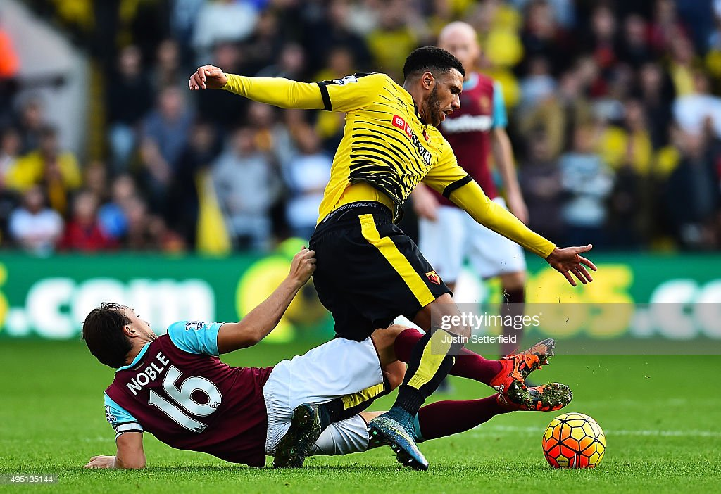 Mark Noble of West Ham United and Etienne Capoue of Watford in action during the Barclays Premier League match between Watford and West Ham United at Vicarage Road on October 31, 2015 in Watford, England.