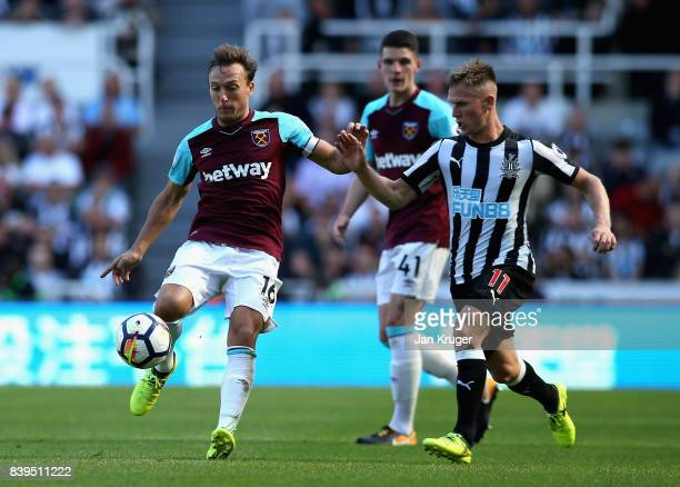 Mark Noble of West Ham United and Matt Ritchie of Newcastle United battle fr possession during the Premier League match between Newcastle United and...