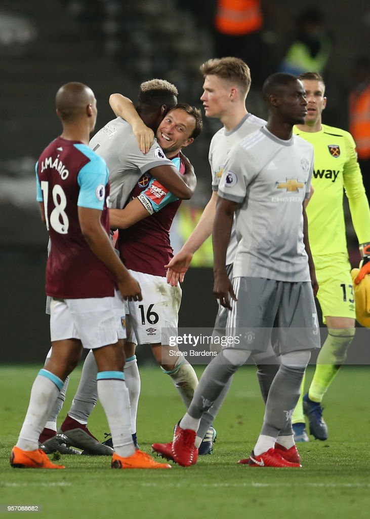 Mark Noble of West Ham United and Paul Pogba of Manchester United hug after the Premier League match between West Ham United and Manchester United at London Stadium on May 10, 2018 in London, England.