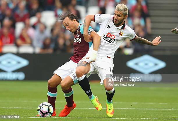 Mark Noble of West Ham United and Valon Behrami of Watford battle for possession during the Premier League match between West Ham United and Watford...